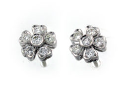 Five Petal Diamond Studs made in 18ct white gold containing 0.48ct of diamond.
